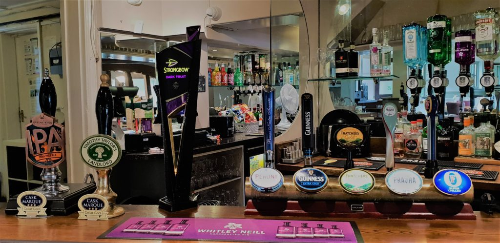 real ale taps and beer taps and bar at the chequers pub stotfold