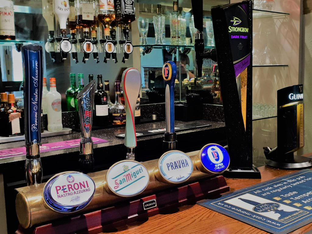 peroni san miguel pravha fosters beer taps on bar at chequers pub stotfold